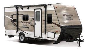 brown and white single axel travel trailer