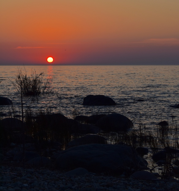 setting sun over lake huron